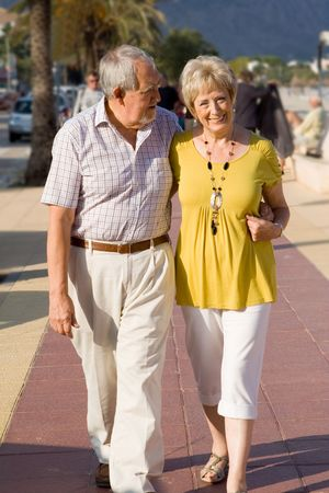 strolling: senior couple strolling on vacation