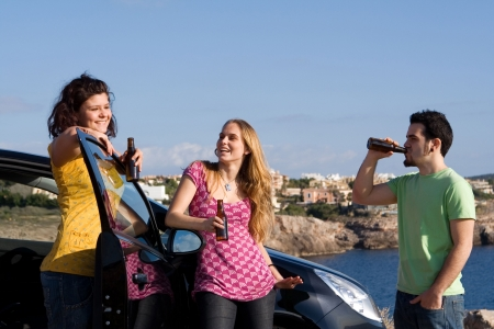 underage kids drinking alcohol on vacation Stock Photo