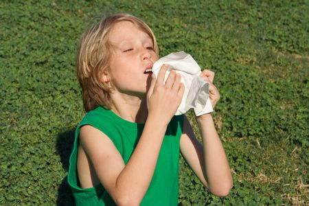 child with allergy sneezing Stock Photo
