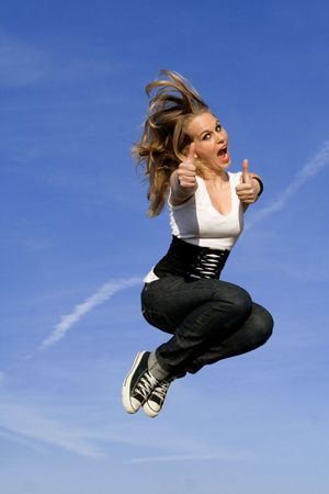happy woman jumping for joy