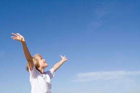 child arms raised in joy photo