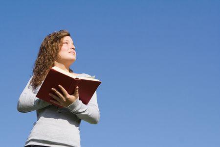 young girl reading bible at bible camp