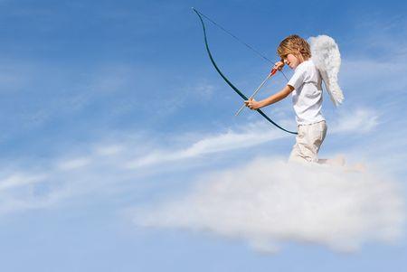 cupid firing bow and arrow (focus on arrow) Stock Photo