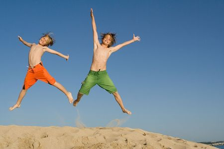 majorca: happy children jumping for joy