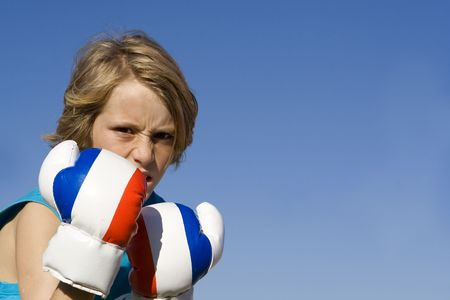 aggresive: child with boxing gloves