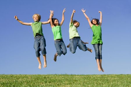 tweens: happy group of kids jumping