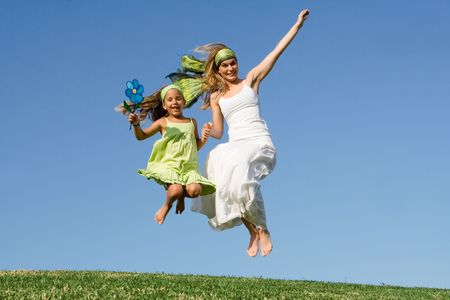 mother and child jumping