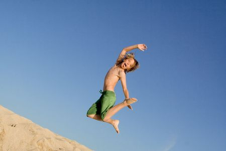 tween boy: happy kid jumping for joy Stock Photo