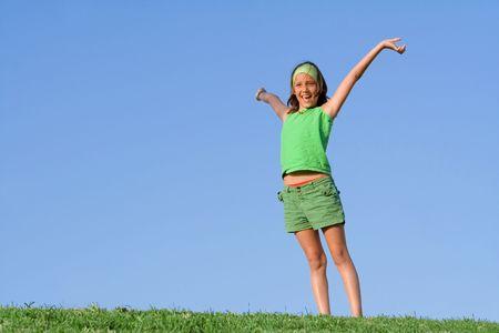 happy child arms raised with joy photo