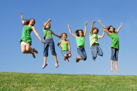 children playing outside: happy group of kids jumping