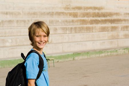 satchel: happy child walking to school with backpack