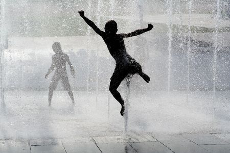 kids playing water: happy child playing in fountaing