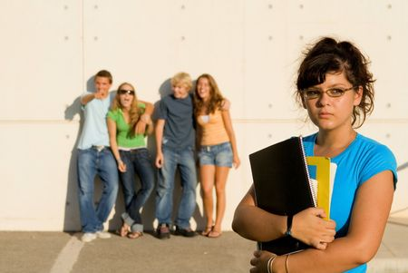 social outcast: student being bullied and jeered at by other students