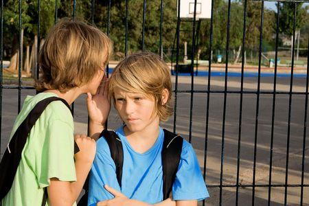 children whsipering secrets Stock Photo
