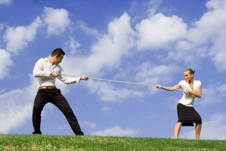 tug of war: tug of war - business concept