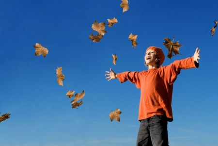 outstretched: happy fall or autumn child