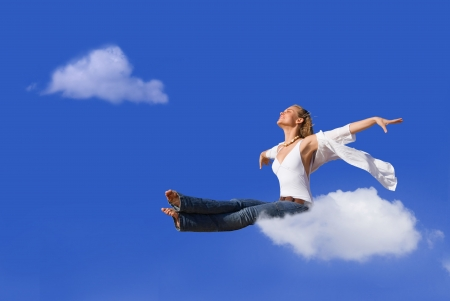 travel concept, woman flying on cloud Stock Photo - 3684470