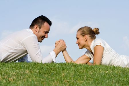 male and female arm wrestling