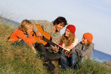 mallorca: happy family with guitar