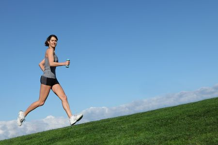 women s health: fit healthy woman running or jogging outdoors