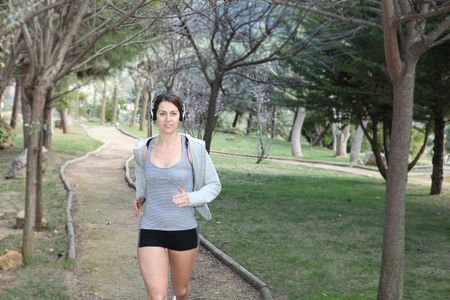 woman running or jogging outdoors