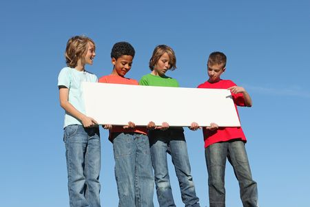 multi race: group of diverse kids with blank sign Stock Photo