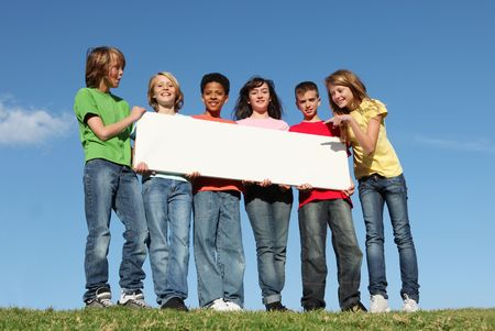 multi racial group: group of deverse kids with sign Stock Photo
