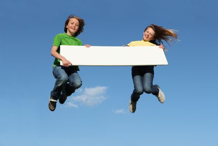 kids with blank sign jumping Stock Photo