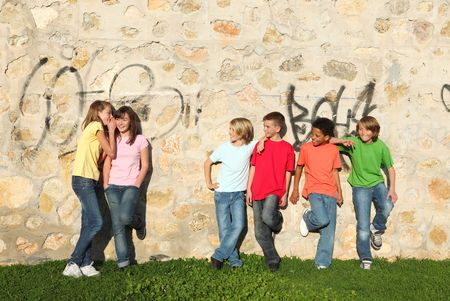 group of kids flirting and whispering Stock Photo - 4434089