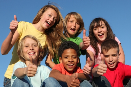 tweens: group of diverse kids with thumbs up
