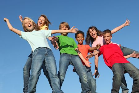 tweens: group of diverse kids with arms outstretched
