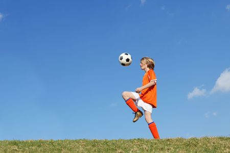 tweens: football or soccer Stock Photo