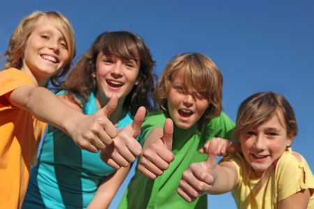 tweens: group of tweens with thumbs up Stock Photo