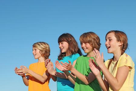 group of kids clapping Stock Photo - 4556148