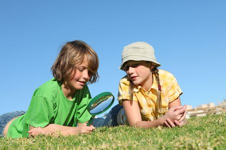 kids with magnifying glass Stock Photo - 4569073