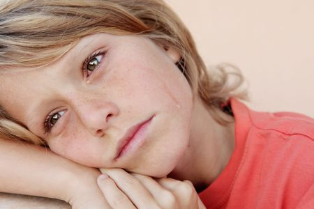 sad unhappy child crying with visible tears on face photo