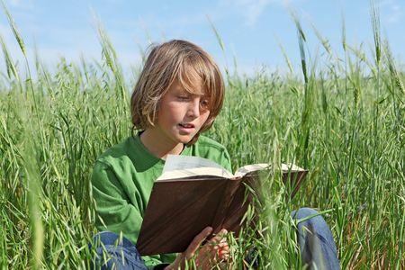 happy child reading outdoors Stock Photo - 4757495