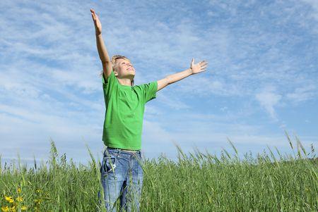 christian worship: happy child arms raised in joy