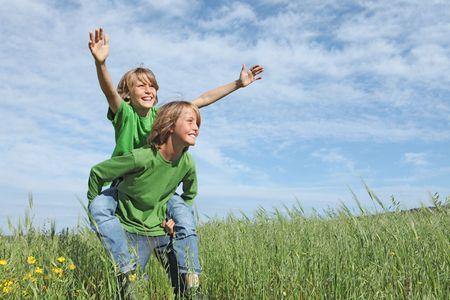 kids playing piggyback racing Stock Photo - 4757493