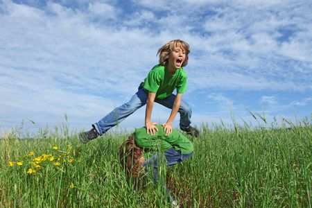 tweens: happy kids playing leapfrog