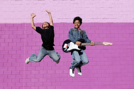 teens jumping, dancing photo