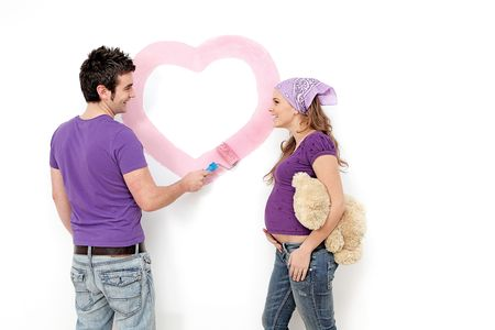 young pregnant women painting with husband Stock Photo