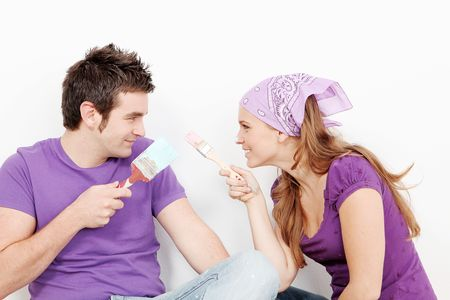 young couple painting first home Stock Photo - 6175497