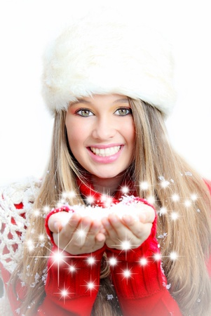 make a gift: A young woman with a hand full of christmas wishes Stock Photo
