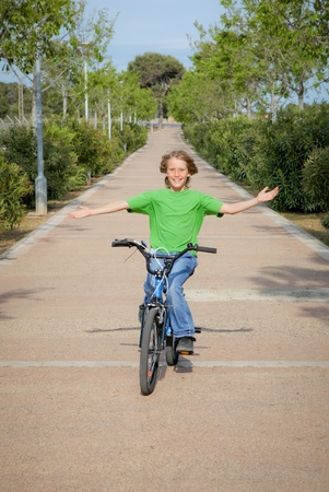 confident child riding bike or bicycle Stock Photo - 8398677