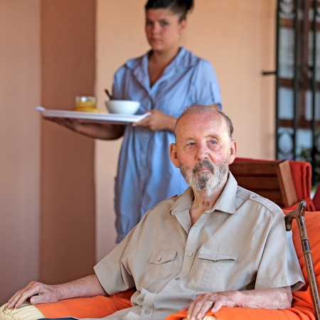 care at home: elderly senior man with carer Stock Photo