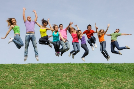 group of teens jumpingat summer camp photo