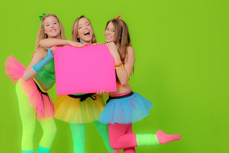 teen girls at party holding board photo