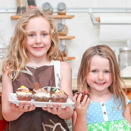 Children cooking or baking cupcake cakes photo