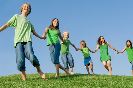 tweens: Happy healthy lifestyle kids walking on hill